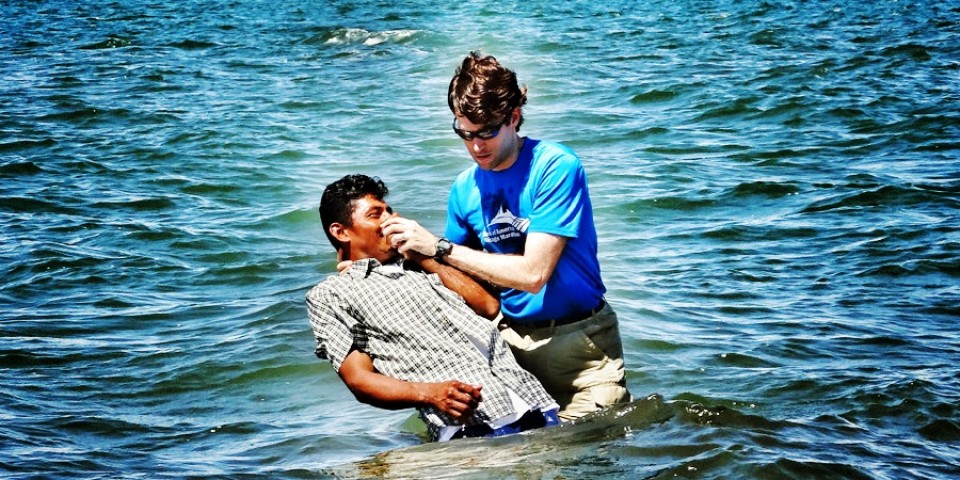Baptizing Ermis Alonzo Nuñez into Christ in the Pacific Ocean off the island of Boca.
