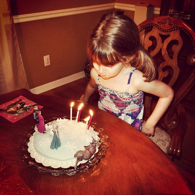 Sara Blowing Out The Candles On Her Frozen Cake Happy 5th