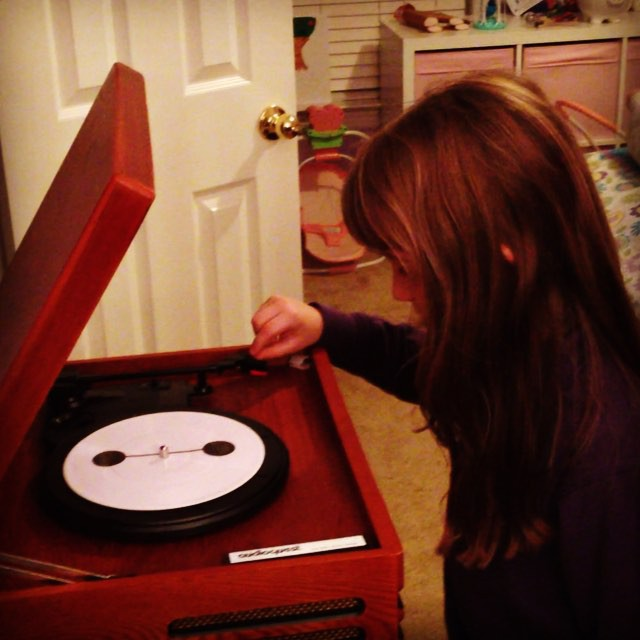 "Sara just got a record player in her room & tonight I've been teaching her how to play some #vinyl. We started out with ""Immortals"" by Fall Out Boy from Big Hero 6. #family #music"