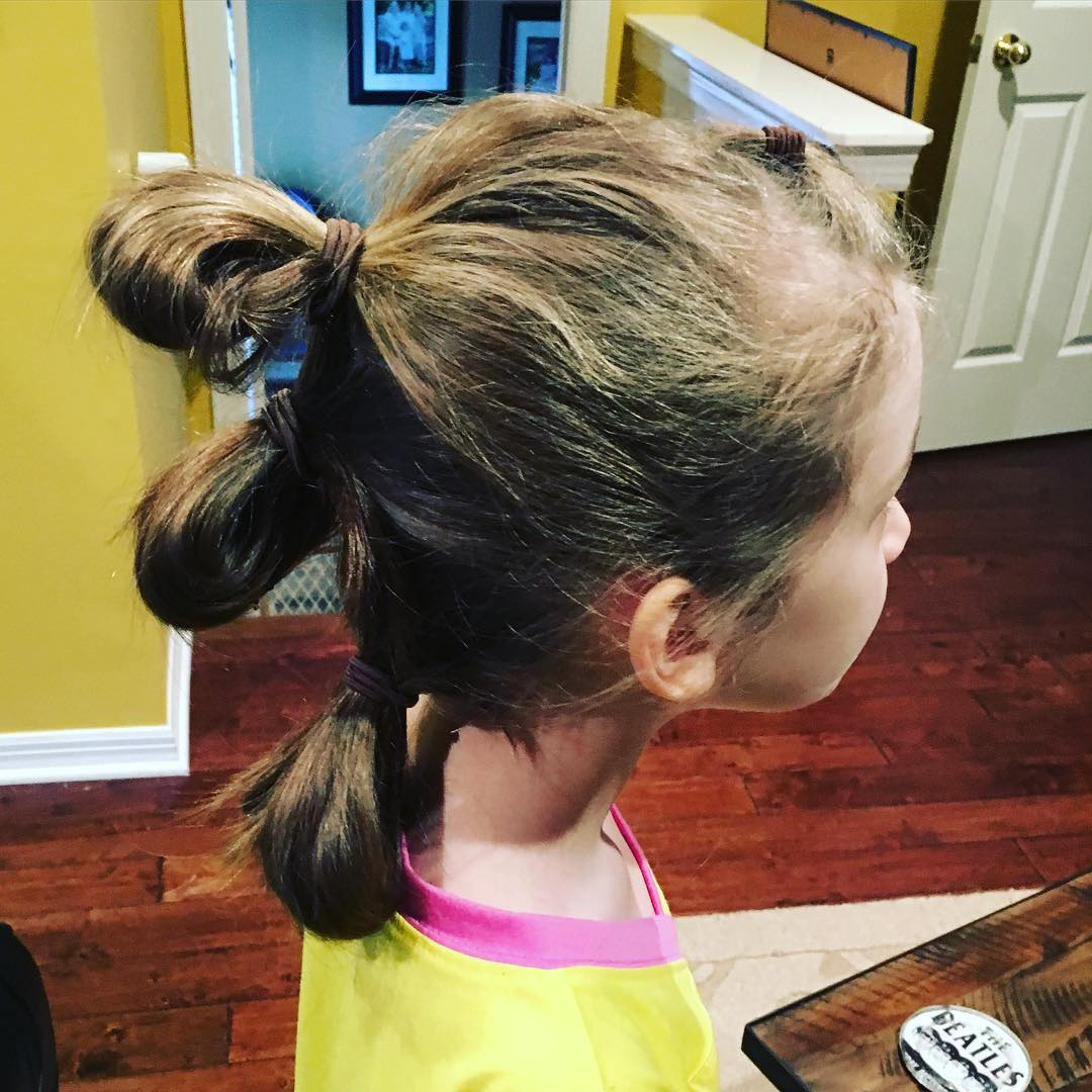 Love Sara's Rey hairdo from #StarWars #TheForceAwakens. Strong female lead = both of my daughters thinking it is the best movie ever. So fun that they are experiencing the same thing I did as a kid! #family