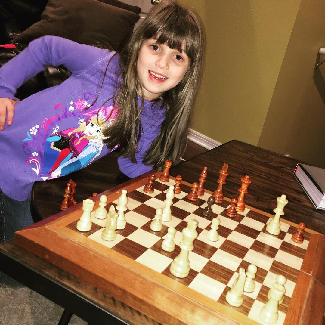 Playing chess with this cutie while listening to some #vinyl records. #family