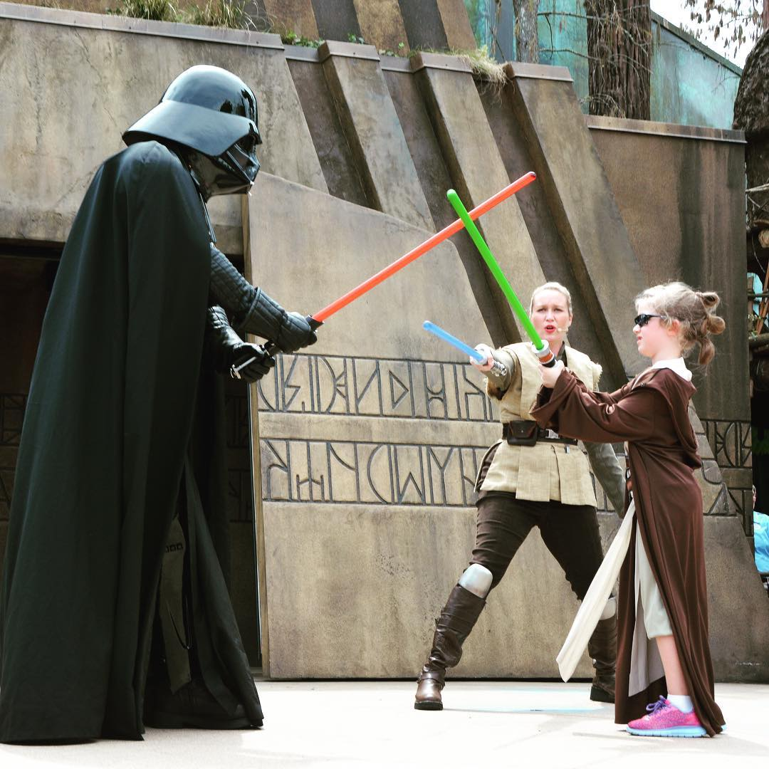 """Sara """"Baby Rey"""" Agee throwing down with Darth Vader during Jedi Training at #Disney Hollywood Studios. #travel #family #StarWars"""