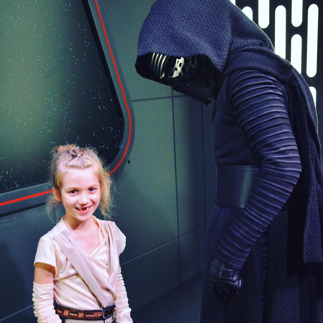 "Sara ""Baby Rey"" Agee simply laughs as Kylo Ren tries to stare her down. #Disney #StarWars #family #travel"