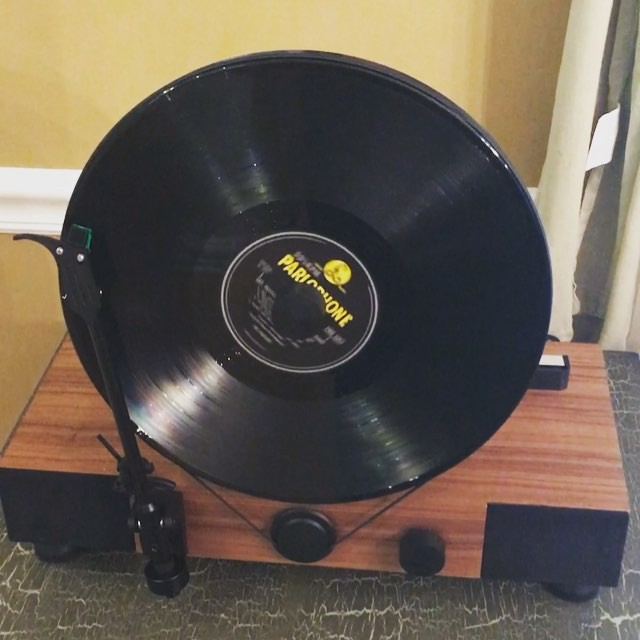 """Testing out our new """"Floating Record"""" vertical turntable that arrived while we were gone on vacation. For our first play, Sara selected Sgt. Peppers from #TheBeatles #vinyl #music"""
