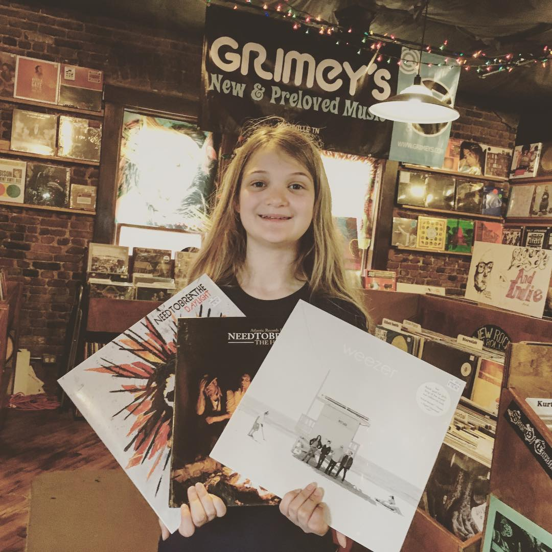 So glad to have Kate home from a 3-day, out of state field trip! After picking her up this afternoon we swung by @grimeys to pick up some fresh #vinyl from @needtobreathe and Weezer. #music #family