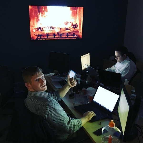 Working by the light of the fire at Formos Consulting with a little Christmas music. #itsgettinghotinhere