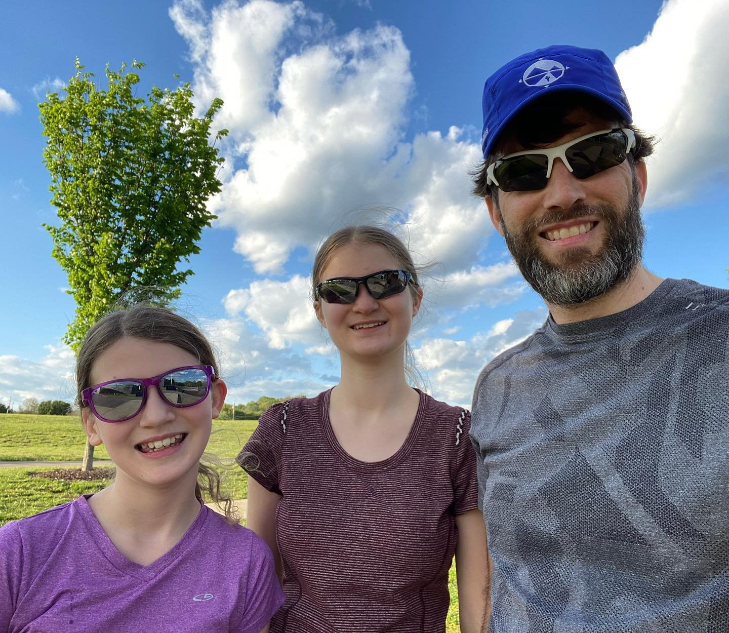 """The girls just finished their first ever speed workout at the """"track"""" behind the Bellevue Library. They've been working really hard on their running over the past couple of months. Very proud of them. #family #running"""
