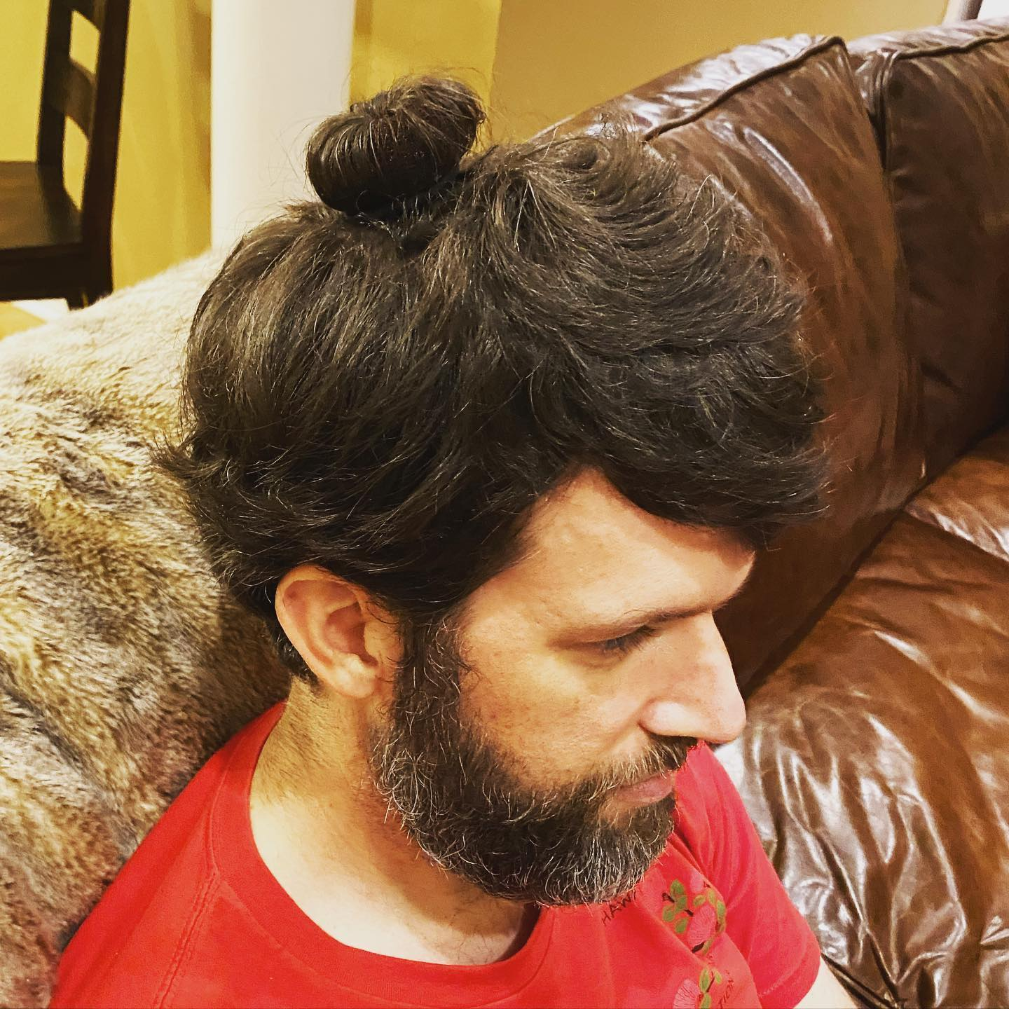 """Sara asked if she could do my hair with the new hair donuts she got for her birthday. The resulting """"man bun"""" was not a look I was ever hoping to see for myself. #family #manbun"""